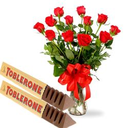 Red Roses Arranged In Vase With Toblerone Chocolates