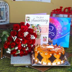 Red Roses Bouquet with Celebration Chocolates and Butterscotch cake Anniversary Greeting Card