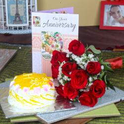 Red Roses Hand Tied Bunch and Pineapple Cake with Anniversary Greeting Card