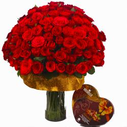 Red Roses in Vase with Almond Chocolates