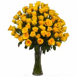 Seventy Five Yellow Roses in a Glass Vase