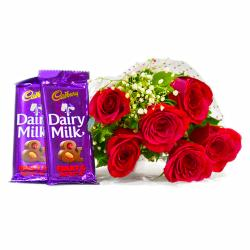 Six Red Roses Bouquet with Bars of Cadbury Fruit and Nuts Chocolate