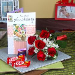 Six Red Roses Hand Bunch and Assorted Chocolates with Anniversary Greeting Card