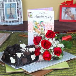 Six Red Roses Hand Tied Bunch and Heart Shape Chocolate Cake with Anniversary Greeting Card