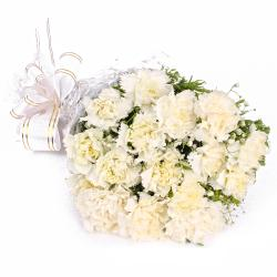 Sixteen White Carnations Cellophane Wrapped