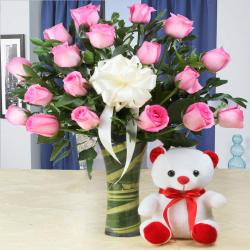 Teddy Bear with Pink Roses Arranged in Glass Vase