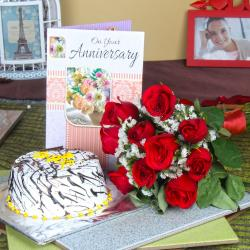 Ten Red Roses Hand Tied Bunch with Vanilla Cake and Anniversary Greeting Card