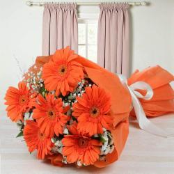 Tissue Wrapped Orange Gerberas Bouquet