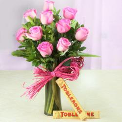 Toblerone Chocolates with Ten Pink Roses in Glass Vase