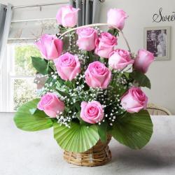 Twelve Pink Roses in a Basket