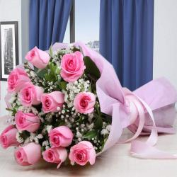 Twelve Pink Roses Wrapped in Tissue