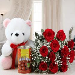 Twelve Roses Bouquet and Teddy Bear with Tasty Gulab Jamuns