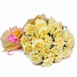 Twenty Five Light Yellow Carnations in Tissue Wrapped