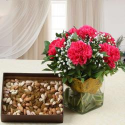 Vase of Pink Carnations and Assorted Dry Fruits