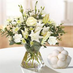 Vase of White Flowers With Rasgulla
