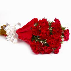 Bunch Of 10 Stems Red Color Carnations In Tissue Wrapped For Raipur