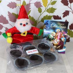 Cup Cake and Christmas Greeting Card with Toy Santa