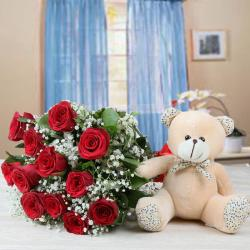 Cute Teddy With Twelve Red Roses For Hyderabad