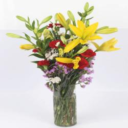 Glass Vase of Lilies and Carnations