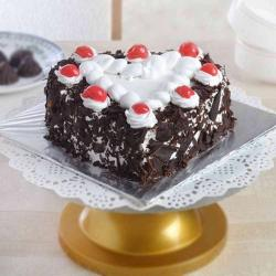 One Kg Heart Shape Black Forest Cake Treat for Surendranagar
