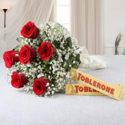 Toblerone Chocolate with Romantic Red Roses for Eluru